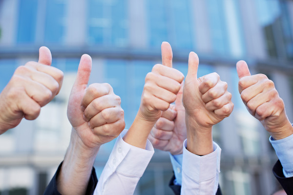 business-people-thumbs-up-praise-effort-not-ability