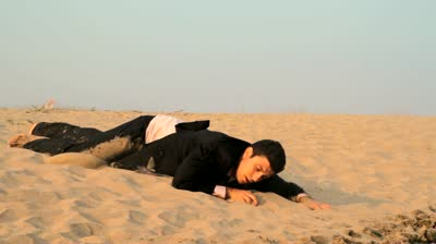 stock-footage-dirty-tired-exhausted-man-suit-reaching-water-desert-salvation