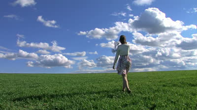 stock-footage-woman-walking-on-spring-grass
